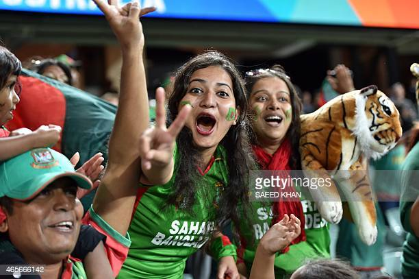 Bangladeshi fans celebrate their team's victory in the 2015 Cricket World Cup Pool A match between Bangladesh and England at the Adelaide Oval on...