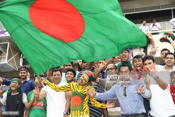 Bangladeshi fans cheer after Bangladesh defeated Australia during day four of the First Test match between Bangladesh and Australia at Shere Bangla...
