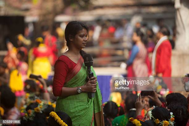 Bangladeshi female news presenter presented festival news during the quotBasanta Utsabquot or spring Festival in Dhaka on February 13 2015 Hundreds...