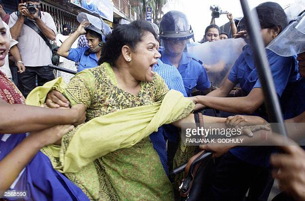 Bangladeshi female riot police arrest a woman activist of the main opposition Awami League 27 September 2003 during an antigovernment protest Police...
