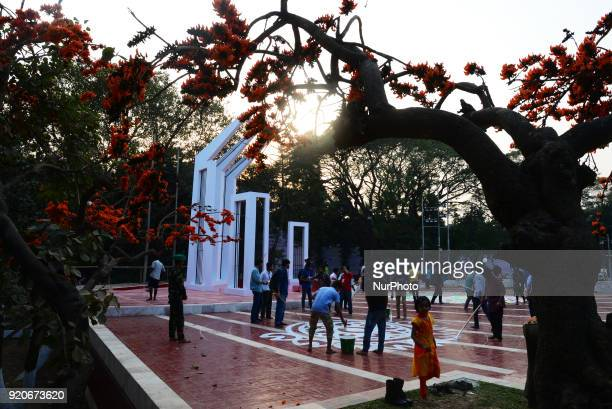 Bangladeshi fine arts students and teachers paints on the ground of the Central Shahid Minar in Dhaka on February 19 as part of preparations for the...