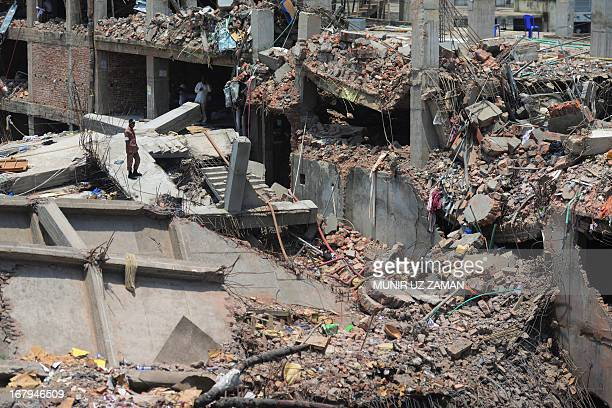A Bangladeshi firefighter stands amid the debris as rescue and army personnel continue recovery operations after the eightstorey building collapsed...