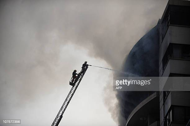 Bangladeshi firefighters attempt to extinguish a blaze at the Hamim Group garment factory at Ashulia on December 14 2010 A raging fire on December 14...