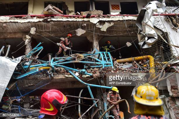 TOPSHOT Bangladeshi firefighters take part in a search and rescue operation at a destroyed garment factory in Gazipur on July 4 after a boiler...
