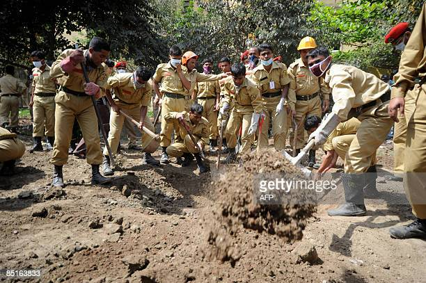 Bangladeshi firefighters uncover a mass grave discovered at the Bangladesh Rifles headquarters in Dhaka on February 28 2009 Bangladeshi soldiers...