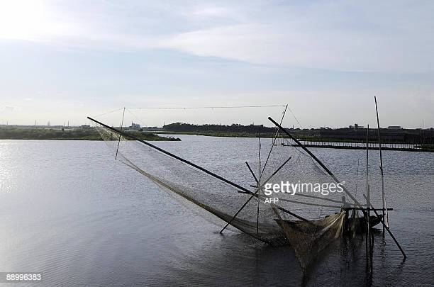 A Bangladeshi fisherman casts his net into the Buriganga river in Dhaka on July 13 2009 Bangladesh is one of the poorest nations on the planet with...