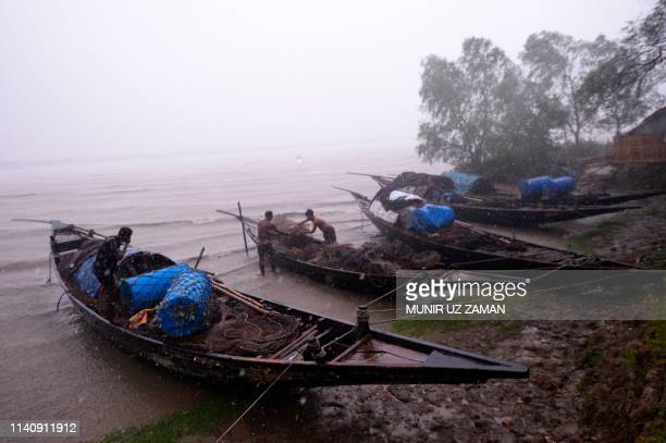 Bangladeshi fishermen moor their boats in Khulna on May 3 as Cyclone Fani barrels northeastwards into West Bengal state and towards Bangladesh Two...