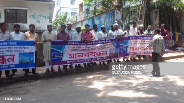 Bangladeshi fishermen stage a protest in Cox's Bazar on May 26 after the government imposed twomonth long fishing ban on the Bay of Bengal Hundreds...
