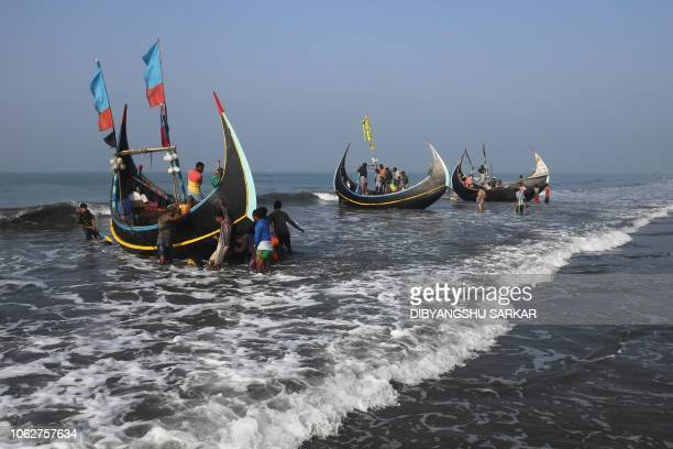 Bangladeshi fishermen unload their catch from fishing boats at Shaplapur fishing village in the Ukhia area of Bangladesh on November 17 2018