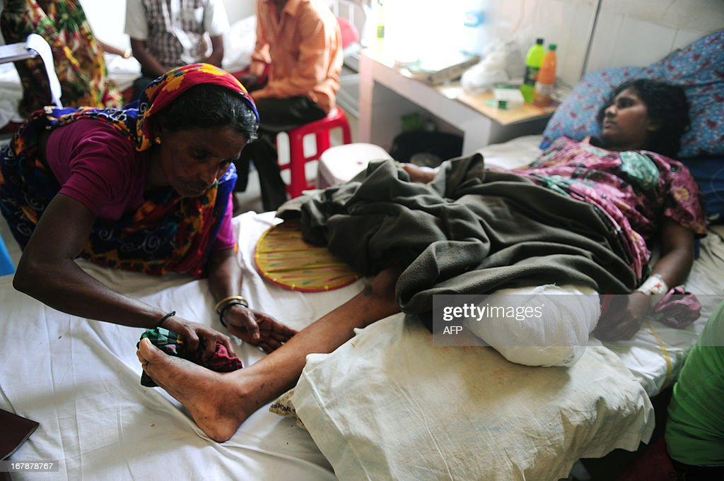 A Bangladeshi garment worker who was rescued from a building that collapsed, lies in a hospital bed with an amputated leg, in Savar, on the outskirts of Dhaka, on May 2, 2013. Bangladesh authorities have suspended the mayor of Savar satellite town outside the capital for approving the faulty construction of a building that collapsed last week, killing 429 people. AFP PHOTO/ Munir uz ZAMAN