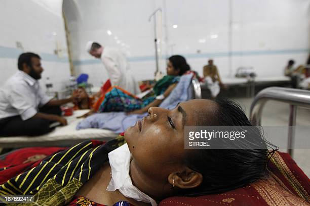 Bangladeshi garment worker who was rescued from a building that collapsed, lies in a hospital bed at the Dhaka medical hospital in Dhaka on May 2...