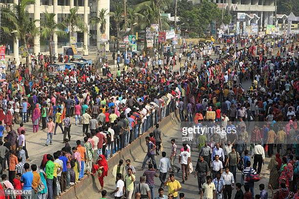 Bangladeshi garment workers bloack a street during a protest in Gazipur 40 km north of Dhaka on September 23 2013Angry Bangladeshi garment workers...