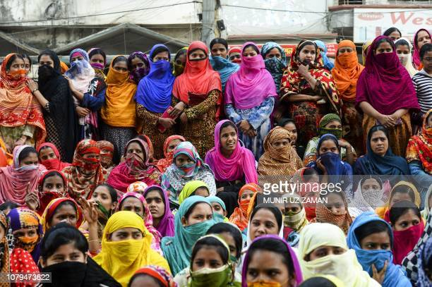 Bangladeshi garment workers block a road during a demonstration to demand higher wages in Dhaka on January 9 2019 Bangladeshi police on January 9...