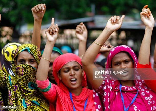 Bangladeshi garment workers shout slogans during a demonstration in Dhaka The workers were demanding salary increases and a festival bonus ahead of...