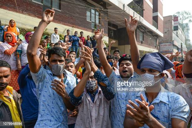 Bangladeshi garment workers shout slogans during a demonstration to demand higher wages in Dhaka on January 10 2019 The readymade garment workers...