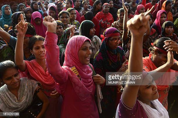 Bangladeshi garment workers shout slogans during a protest on wage increases in Dhaka on September 21 2013 Thousands of workers took part in the...