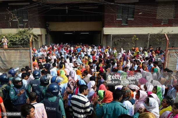 Bangladeshi garment workers stage a demonstration in front of their factory to demand higher wages in Dhaka on January 10 2019 The readymade garment...