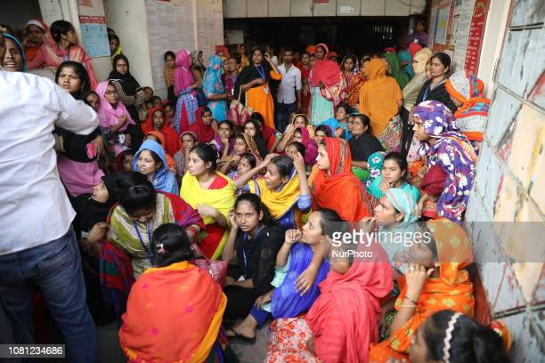 Bangladeshi garment workers stage a demonstration in front of their factory to demand higher wages in Mirpur Dhaka on January 12 2019