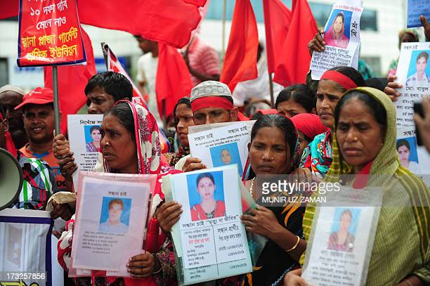 Bangladeshi garment workers,activists and relatives hold portraits of victims as they gather with others in front of the Bangladesh Garment...