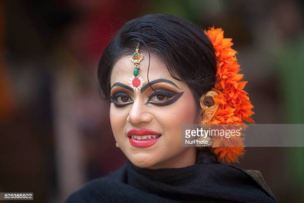 A Bangladeshi girl has decorated herself with flowers as they celebrate the arrival of spring on the first day of Falgoon at the Dhaka University...