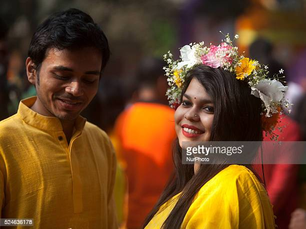 A Bangladeshi girl has her head decorated with flowers as they celebrate the arrival of spring on the first day of Falgoon at the Dhaka University...