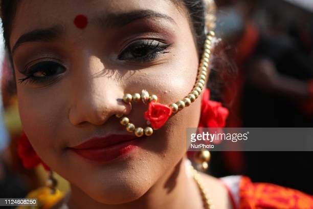 A bangladeshi girl looks at the camera as she came at Charukola Dhaka University Campus to celebrate Pohela Falgun Photo has taken on Wednesday...