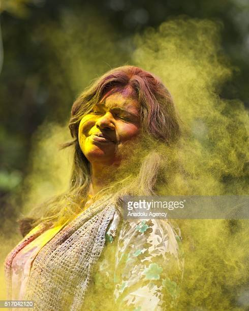 Bangladeshi girl plays with colored powders during Holi celebrations in Dhaka Bangladesh on March 23 2016 Holi is the festival of colors fun and...