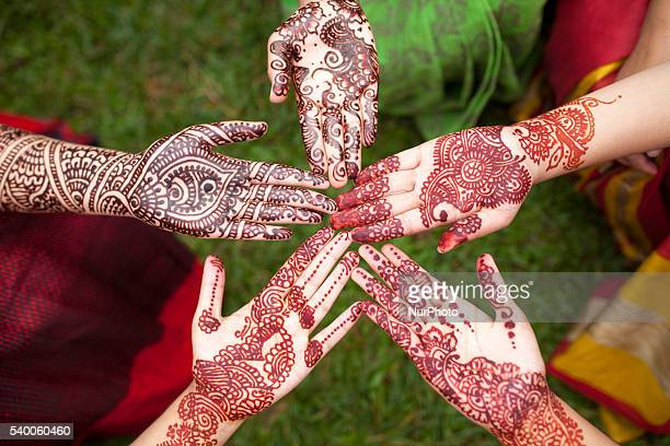 Bangladeshi girl shows her hand decorated with henna during the Mehendi Festival a festival ahead of Ramadan in Dhaka Bangladesh on June 11 2016...