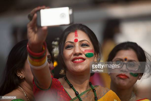 Bangladeshi girl taking selfi during the quotBasanta Utsabquot or spring Festival in Dhaka on February 13 2015 Hundreds of people joined in the...