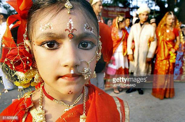 Bangladeshi girl wearing a traditional wedding dress takes part in a march in Dhaka 07 December 2002 on the occasion of the EidalFitr celebrations...