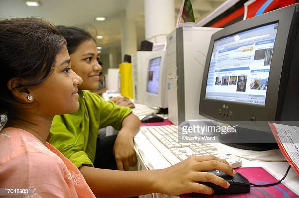 Bangladeshi girls browsing the Internet at a computer fair in Dhaka the capital city of Bangladesh Dhaka Bangladesh April 28 2006