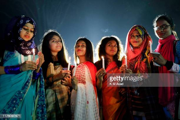 Bangladeshi girls poses for picture attend a candle light event at night to mark International Women's Day Every year 8th March International Womans...