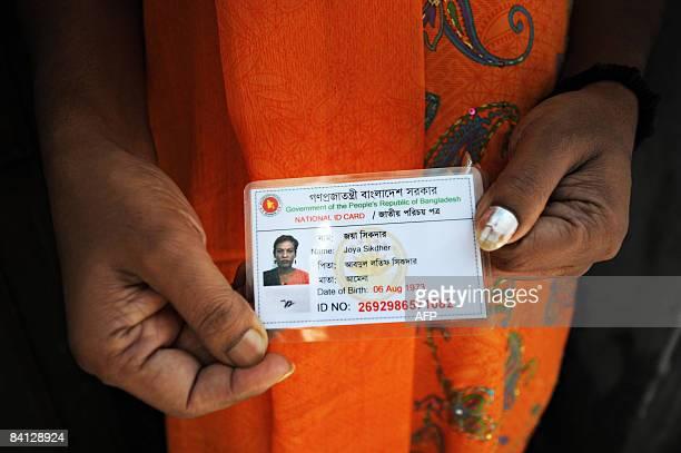 STORY BANGLADESHVOTEEUNUCHSFOCUS BY SHAFIQ ALAM Bangladeshi 'hijra' social worker Joya Shikder holds her national identity card at her house in Dhaka...