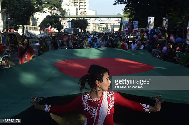 A Bangladeshi hijra transgender holds a national flag during a rally to mark the first ever nationwide program to observe 'Hijra Day' in Dhaka on...
