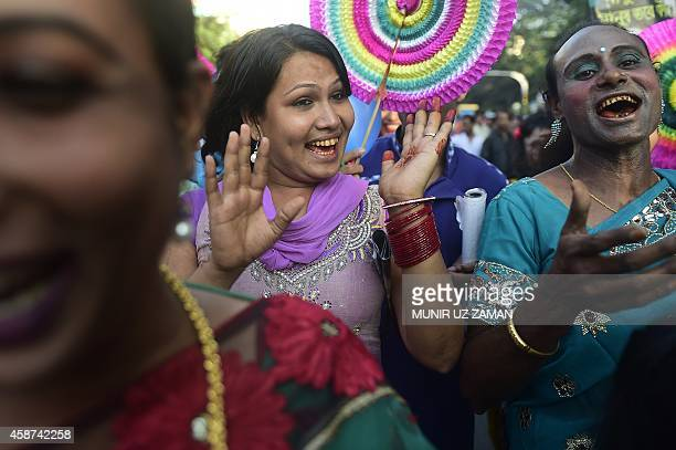 Bangladeshi hijras transgenders dance in the street during a rally to mark the first ever nationwide program to observe 'Hijra Day' in Dhaka on...