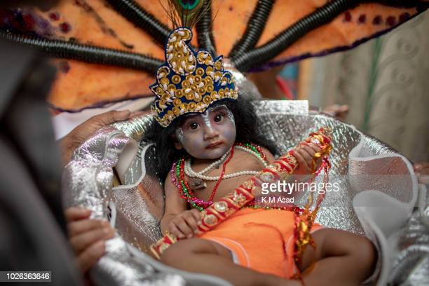 Bangladeshi Hindu child devotee dressed like Lord Sri Krishna take part in the celebration of the religious festival Janmashtami, marking the birth...