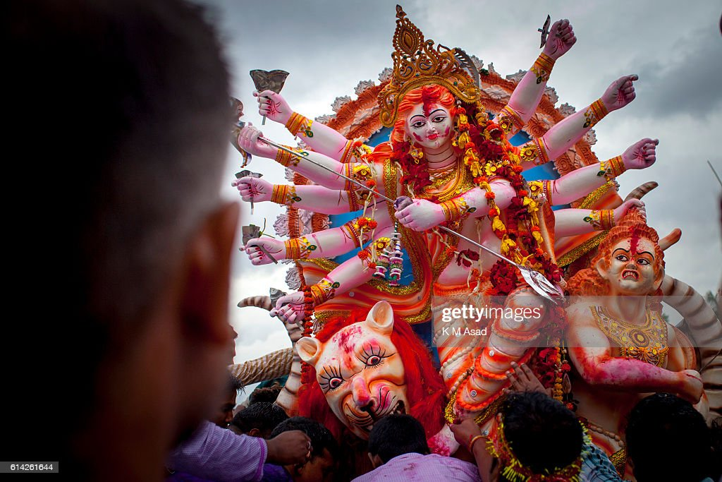 DHAKA SHADARGHAT DHAKA BANGLADESH Bangladeshi Hindu community devotes carry to immerse a statue of their goddess during the final day of the Durga...