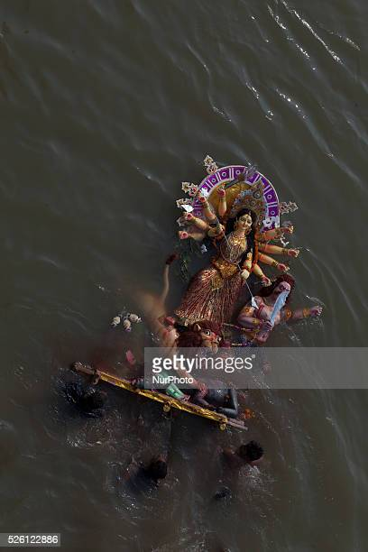 Bangladeshi Hindu devotees immerse an idol of Hindu Goddess Durga into the river Buriganga The Hindu community ended their fourdaylong annual...