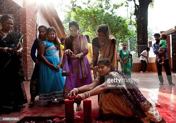Bangladeshi Hindu devotees worship on the final day of the Durga Puja Festival October 4 2014 in Dhaka Bangladesh Hindus believe that the goddess...