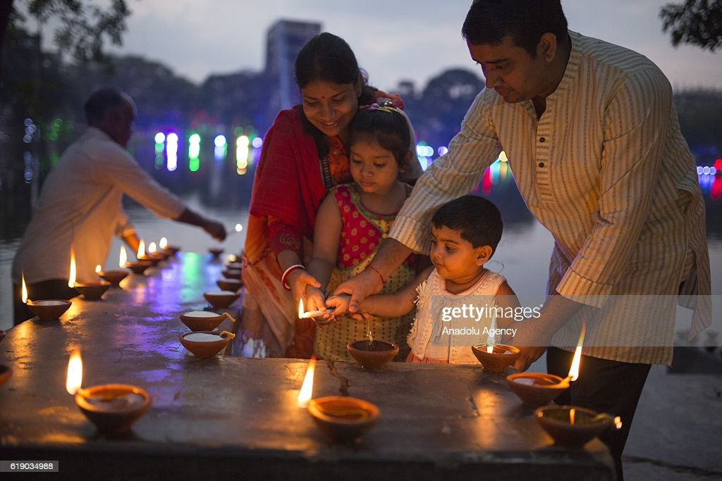 Bangladeshi Hindu people light oil lamps during the 'Deep Utsav or Light festival' ahead of the Diwali festival in Dhaka, Bangladesh, on October 29, 2016. Diwali also known as Deepavali and the ''festival of lights'', is an ancient Hindu festival. Diwali, marks the homecoming of the God Lord Ram after vanquishing the demon king Ravana and symbolises taking people from darkness to light and the victory of good over evil.
