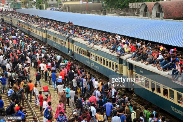 Bangladeshi homebound people ride on the rooftop of a train while returning to their home to celebrate EidAlAdha festival in Dhaka Bangladesh on...