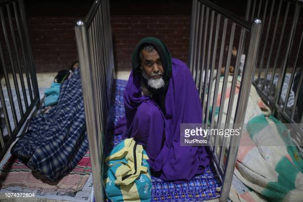 A Bangladeshi homeless man takes shelter at railway station during cold weather in Dhaka Bangladesh on December 19 2018 More than 100 million people...