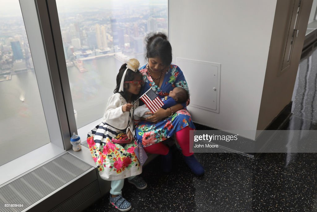 Bangladeshi immigrant Khadijatul Rahman, 29, holds her baby boy Zavyaan, 2 weeks, after becoming a U.S. citizen at a naturalization ceremony held atop the One World Trade Center on August 15, 2017 in New York City. At left is Zavyaan's sister Labeebah, 6. Thirty immigrants took the oath of citizenship to become American citizens at the first such ceremony to be held at One World Trade Center, which at 1,776 feet high is the tallest building in the Western Hemishere.