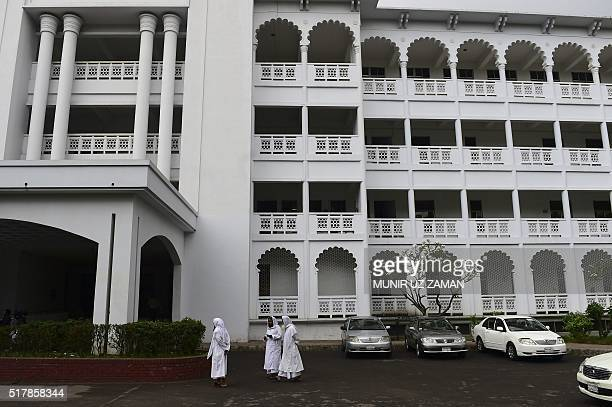 Bangladeshi Islamic leaders wait outside a court as a hearing on the issue of state religion was taking place in Bangladesh High Court on March 28...