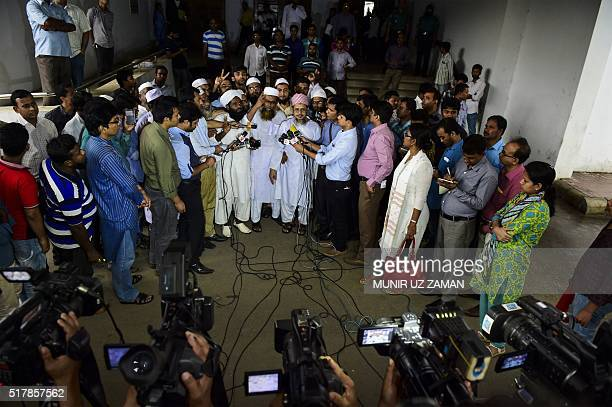 Bangladeshi Islamist leaders flash victory signs as they talk to the media after the Bangladesh High Court rejected a petition challenging Islam as...