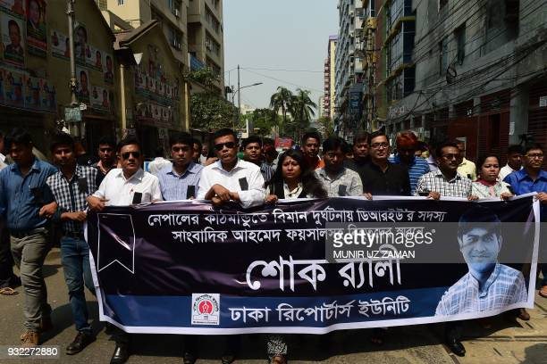 Bangladeshi journalists hold a rally as they observe a national day of mourning in Dhaka on March 15 in memory of the victims of the US-Bangla...