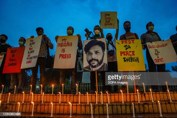 Bangladeshi journalists light candles, hold placards and a portrait of Reuters journalist Danish Siddiqui, in his tribute. Reuters journalist Danish...