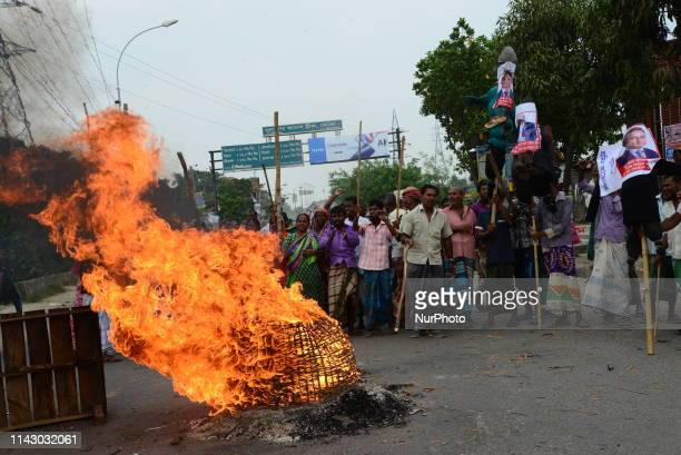 Bangladeshi Jute mill workers stage a road block demonstration to demanding arrears and fair wages at Demra in Dhaka Bangladesh on May 11 2019