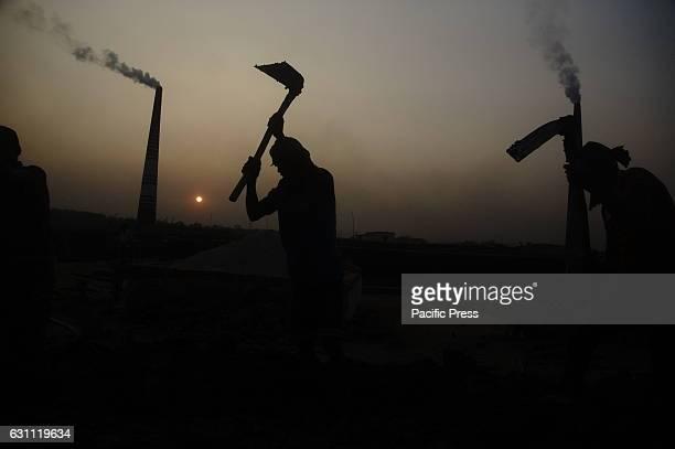 ASHULIA TONGI DHAKA BANGLADESH Bangladeshi laborers are working in a brickfield near Ashulia of the outcast of Dhaka They come from home to Dhaka for...