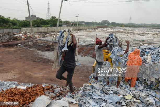 Bangladeshi labourers unload tannery waste at an export processing zone in Savar on September 2, 2019.